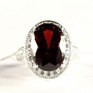 3CT OVAL CUT RED GARNET & CZ HALO SILVER RING
